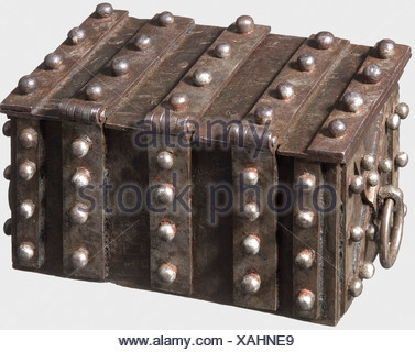 A Nuremberg small strongbox, ca. 1540 Rectangular box made of forged iron sheets. Surrounded by massive reinforcement straps with stud rivets. The hinged lid with three hasps and small triangular locks. On both sides moveable handle rings. Elaborate lock mechanism with two secret locks. On the front a concealed key hole with secret release device. The inside with intricately worked locking mechanism, which reveals the central strap of the lid. On the front a second secret mechanism: when a rivet is turned, a double latch is moved. The lid with elaborate locking, - Stock Photo