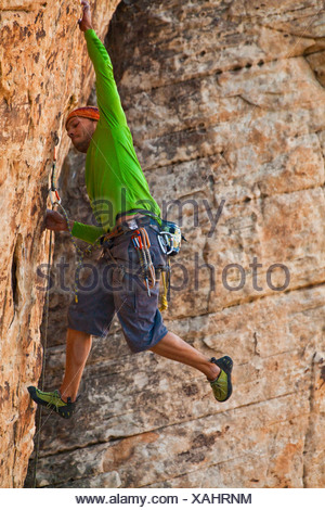 A male climber sport climbing in Red Rocks, Las Vegas, Nevada, United States of America - Stock Photo