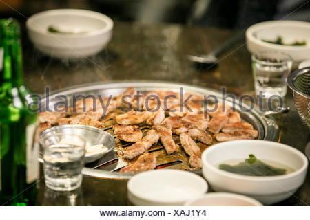 Grilled pork belly with liquor served on table - Stock Photo