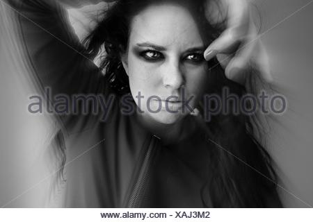 Front View Of Fashion Model Against Gray Background - Stock Photo