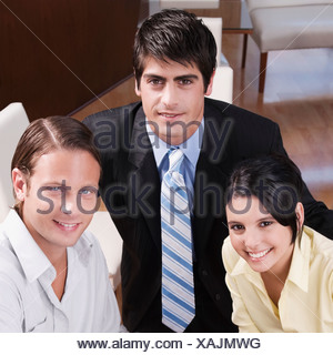 Friends smiling in a restaurant - Stock Photo