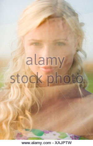 Portrait of a young woman behind a veil - Stock Photo