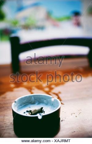 Close-Up Of Ashtray - Stock Photo