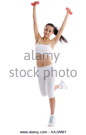 Young woman on exercise - Stock Photo
