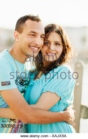 Sweden, Vastra Gotaland, Gothenburg, Young couple embracing - Stock Photo