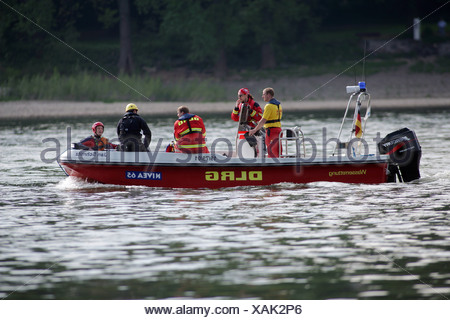Live-savers from the german DLRG during an exercise an a river - Stock Photo