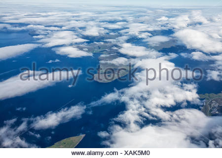 Aerial view through the clouds of the Faroe Islands. - Stock Photo