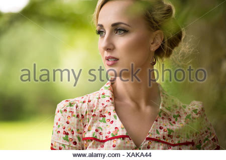 Portrait of a young woman looking away - Stock Photo