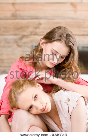 Woman hugging sad girlfriend - Stock Photo