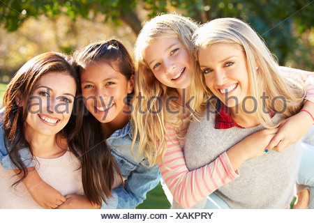 Portrait Of Two Mothers With Daughters - Stock Photo
