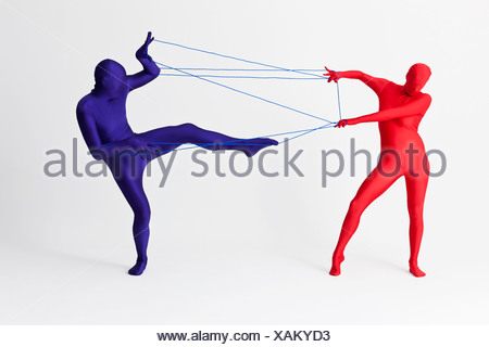 Couple in bodysuits playing with string - Stock Photo