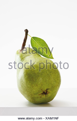 Green pear with leaf, close-up - Stock Photo