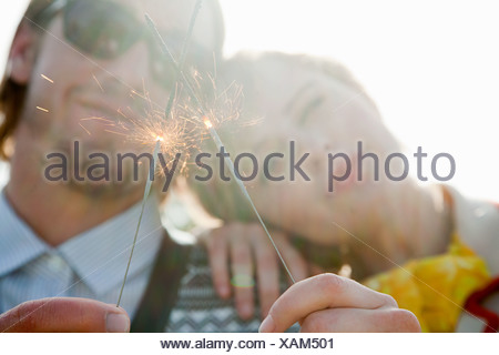 Young couple with sparklers - Stock Photo