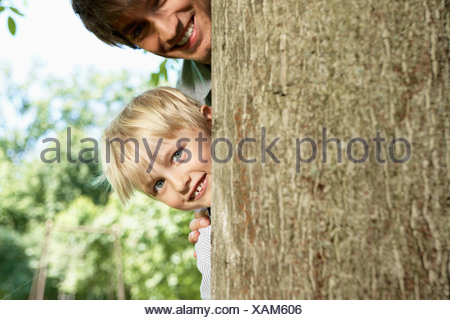 Germany, Cologne, Father and son smiling, portrait - Stock Photo