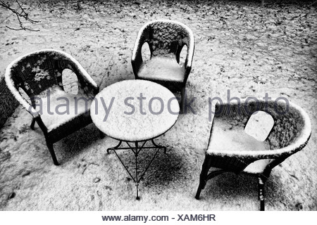 Chairs and table in snowy backyard