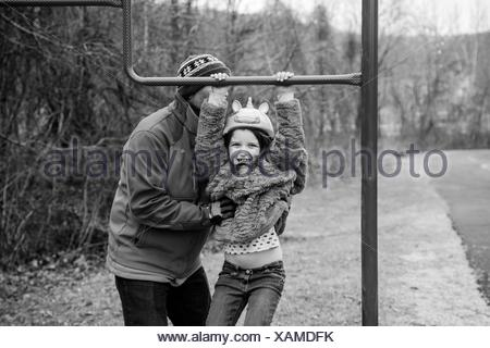 Father And Daughter Playing In Park