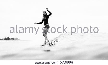 Woman surfing, Malibu, California, USA - Stock Photo