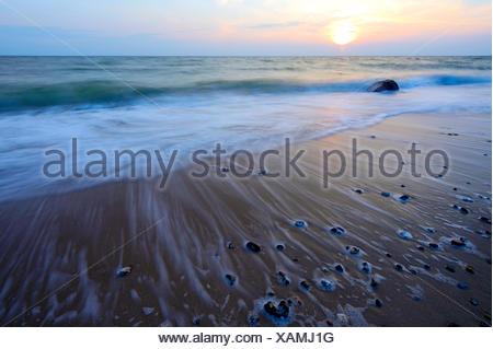 Wave on the Baltic Sea beach, Fehmarn, Schleswig-Holstein, Germany - Stock Photo