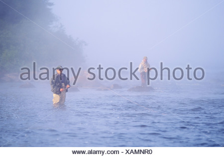 Salmon Fishing in fog on the Upper Humber River, Newfoundland, Canada - Stock Photo