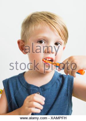 Little boy (2-3) brushing teeth - Stock Photo