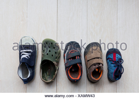 Children's shoes in various sizes from baby to kindergarten-age - Stock Photo