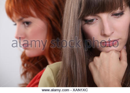 two girlfriends having a quarrel - Stock Photo