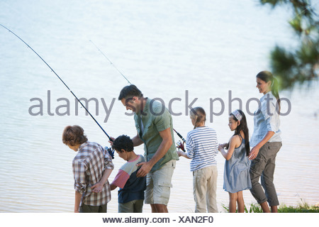 Family fishing in lake - Stock Photo