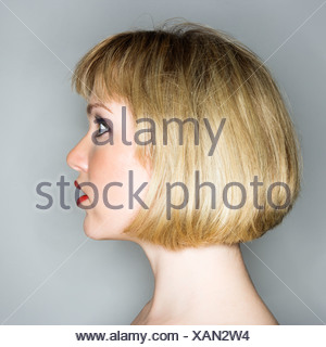 Profile portrait of young blonde caucasian woman who looks surprised