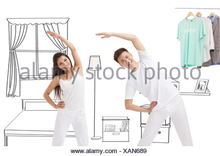Doing gymnastics young couples - Stock Photo