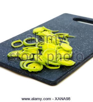 Fresh sliced leek rings on cutting board.