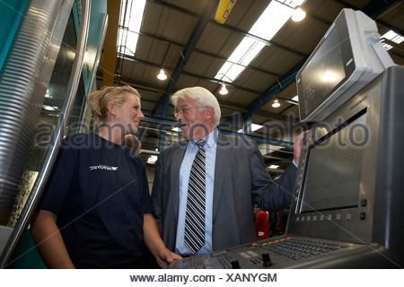 German Foreign Minister, Vice-Chancellor and SPD Chancellor Candidate Frank-Walter Steinmeier talking with an employee of the A - Stock Photo