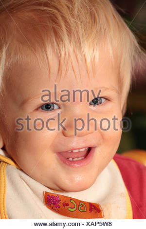 Portrait of a sixteen-months-old baby girl smiling and laughing. - Stock Photo