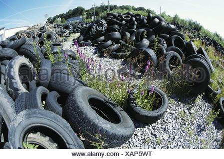 industry scrap metal rubbish metal rubber rubbish disposal tire dump Fisheye tires scrap metal filing pla - Stock Photo