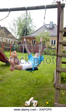 woman swinging - Stock Photo