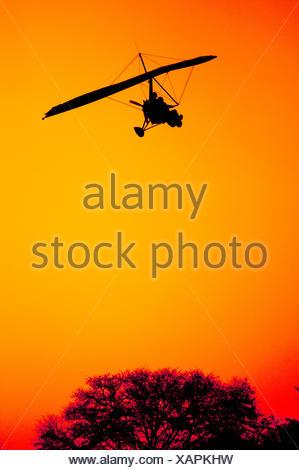 Ultra Light Aircraft on Final Approach - Stock Photo