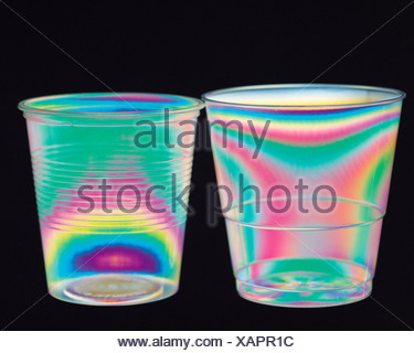 Science. Physics. Stress patterns in plastic cups photographed in polarized light. - Stock Photo