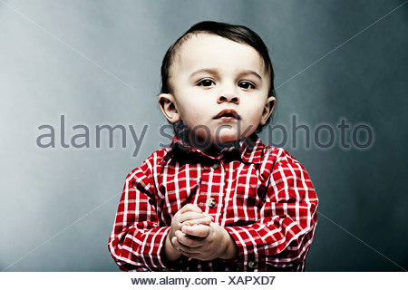 Portrait of baby boy wearing checked shirt - Stock Photo
