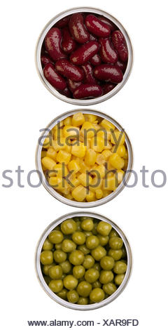 canned beans, peas and maize in metal cans - Stock Photo
