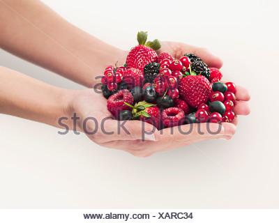 Woman holding berries - Stock Photo