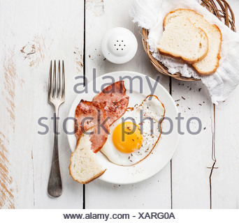 Fried egg with grilled sausage for breakfast - Stock Photo