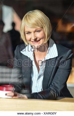 Businesswoman in an open restaurant - Stock Photo