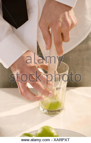 Barkeepers, detail, hands, cocktail, Caipirinha, prepare, glass, limes, mash, - Stock Photo
