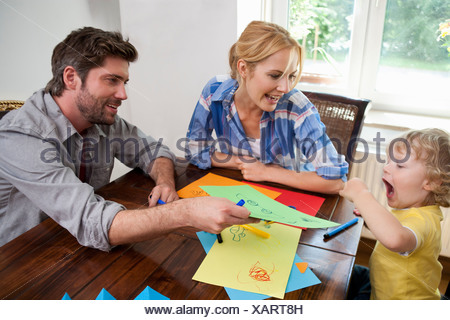 Family handcrafting on table - Stock Photo