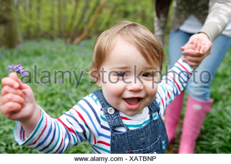 Mother and son playing in forest - Stock Photo