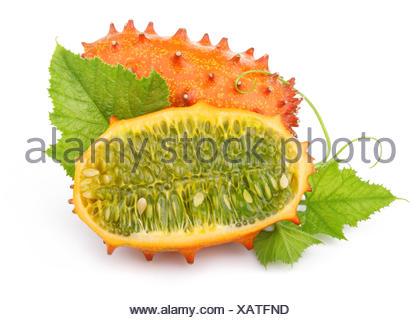 Ripe sliced kiwano fruits isolated on white - Stock Photo