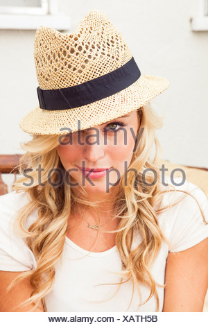 Young woman wearing straw hat - Stock Photo