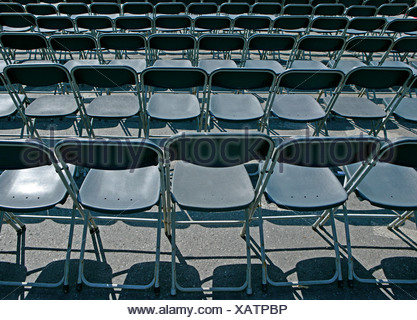 Rows with black chairs, from behind - Stock Photo