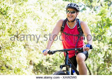 Mature man riding bike - Stock Photo