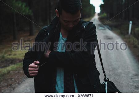 Man On Footpath In Forest - Stock Photo