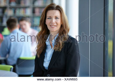 Portrait of mature businesswoman with long hair - Stock Photo